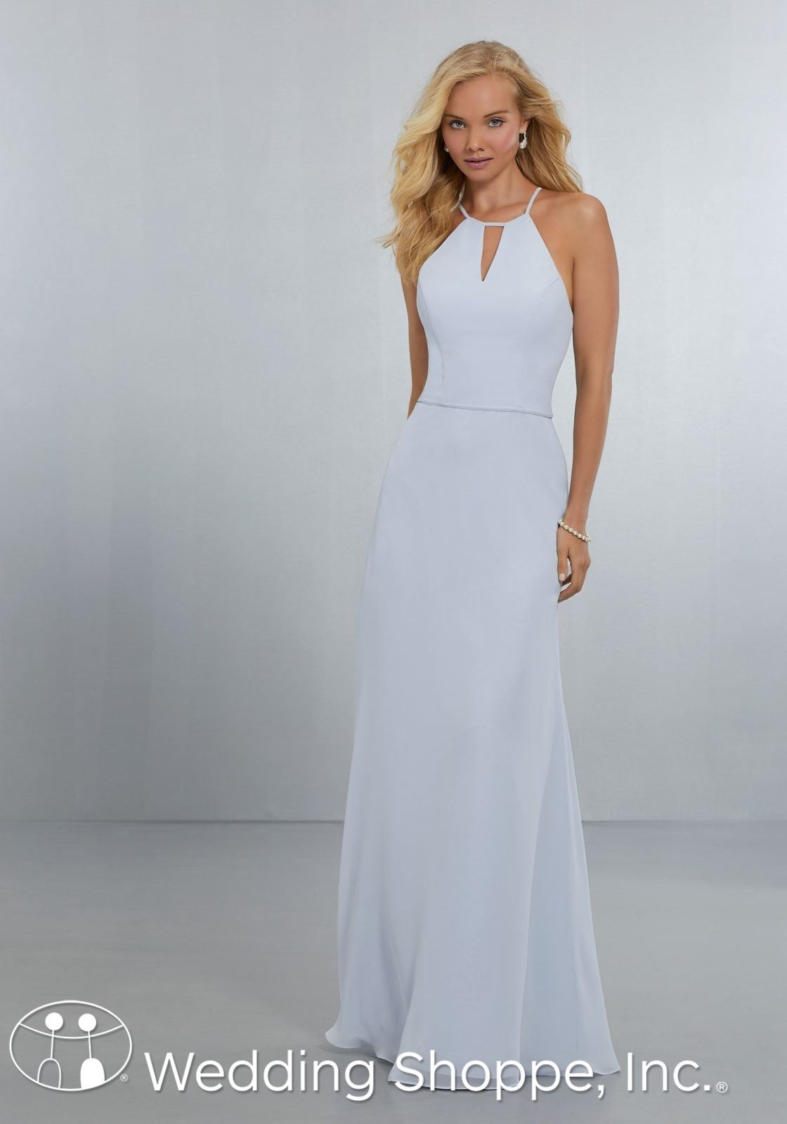 This figure-flattering A-line gown features a high halter neckline ...