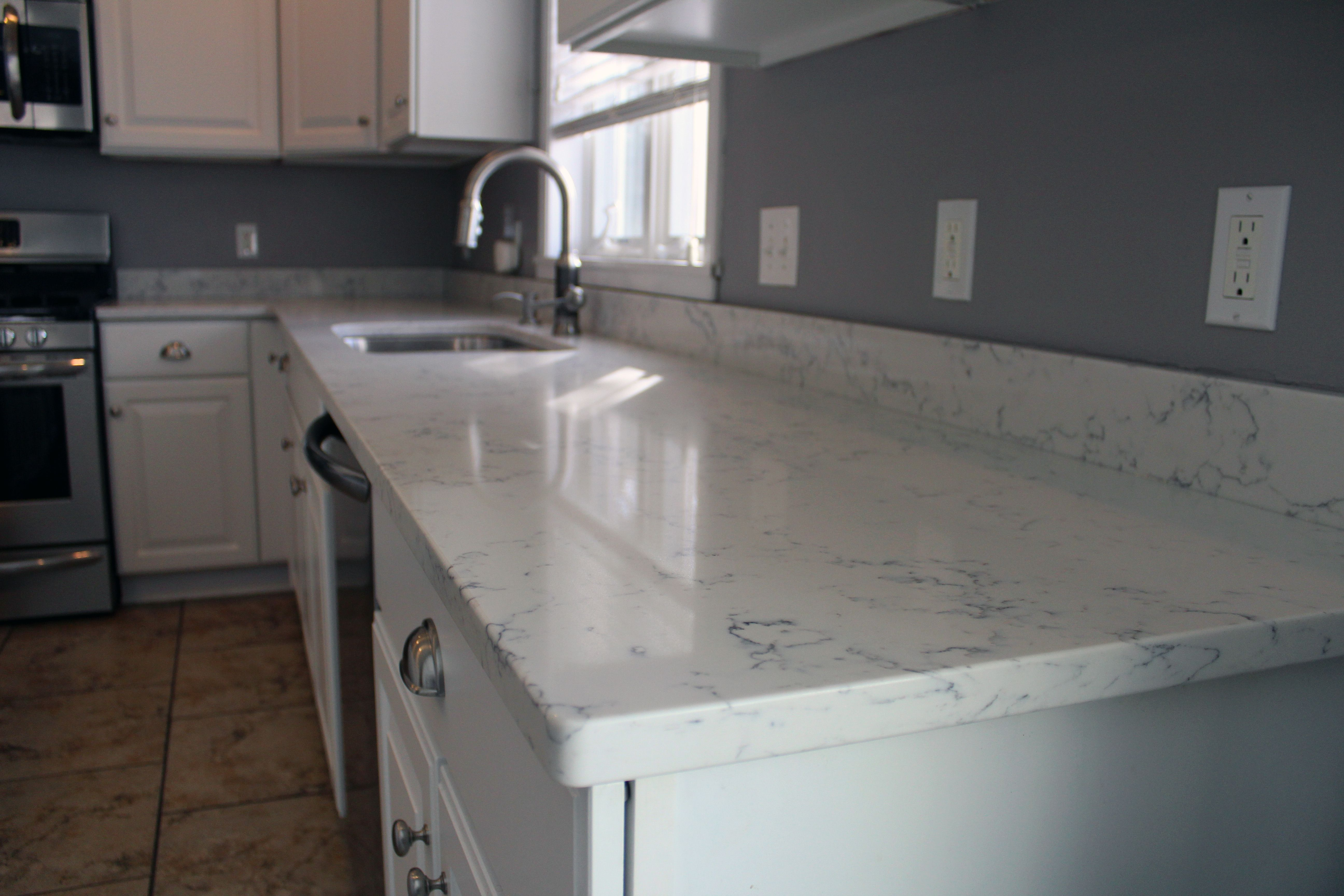 Carrara White Quartz By Aggranite; 502A Sink By Midwest/Aggranite.