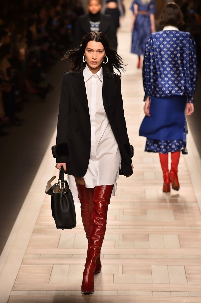 086ee83d8acbdd ... Fashion Week Fall Winter. Bella Hadid Over the Knee Boots - Red  thigh-high boots added a welcome pop of color.