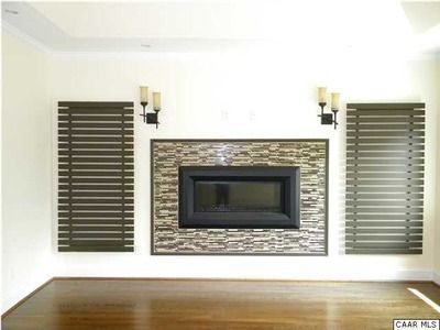 Love the tile around this gas fireplace.