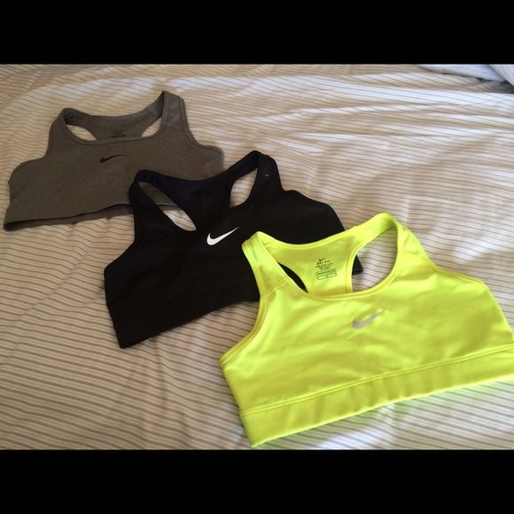 Lot of 3 like new size M nike dry fit sports bras These are 3 like new nike dry fit sports bra. Barely worn. Good for light to heavy activity. Originally paid $25 each. Nike Intimates & Sleepwear Bras