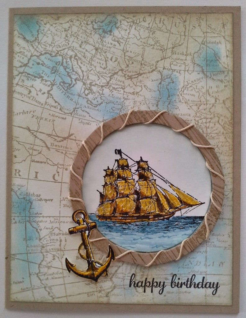 handmade card ... World map Background Stamp ... window cut frame with circle stamped with a woodgrain and wrapped with twine ... sailing ship image ... great card!