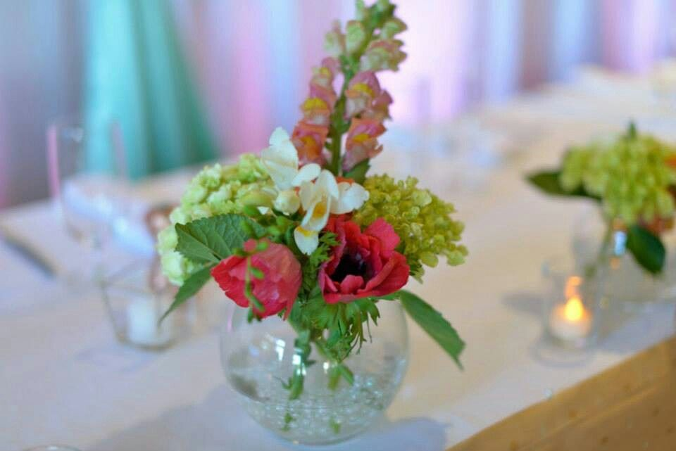 Mint green and coral wedding, head bridal table floral decor by Miya's Elegant Designs