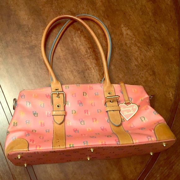 Rooney & Bourke pink handbag Gently used and very clean D & B bag. Great for spring and summer with colorful logos on bag and brass charm. Dooney & Bourke Bags Satchels
