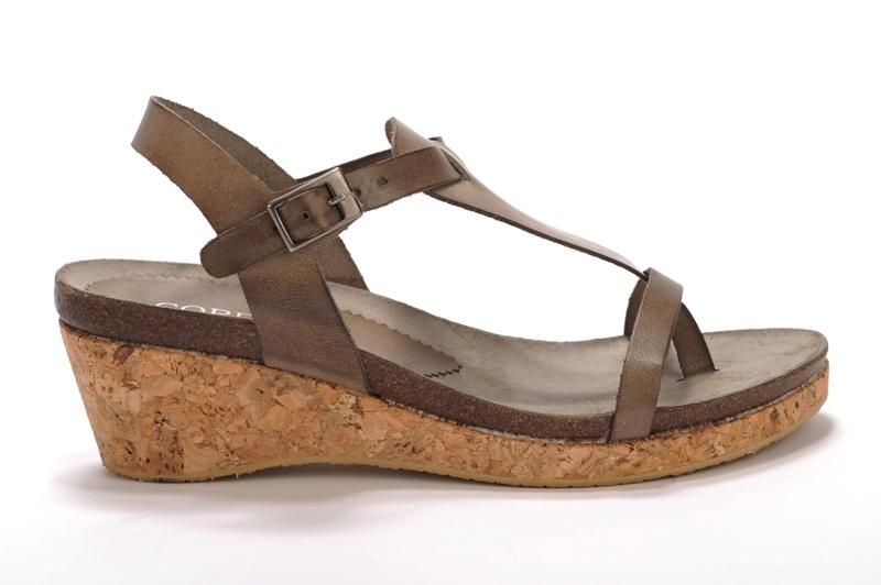 Saber by Cordani This natural-toned cork wedge is your go-to for tapas on the patio or cruising the Boulder Creek Fest. Pairs perfectly with your favorite floral mini or that sleek black maxi dress. • Leather• Cork wedge heel• Rubber sole• Made in Spain • Measurements:- Heel height: 2 1/2 in- Platform height: 3/4 in