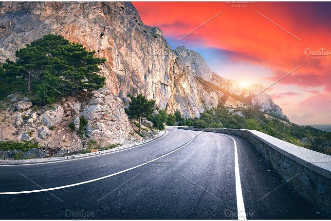 Landscape with beautiful winding mountain road by den ...