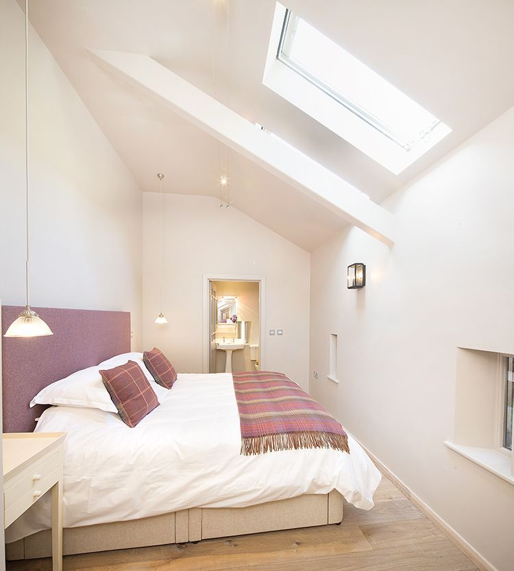 The Barn double room upstairs with plenty of natural light.