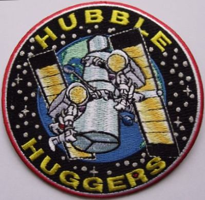 Unofficial patches produced during the shuttle era could be quite stunning. The Hubble Huggers patch was created for scientists and space officials who wanted to push for Hubble's repair in the troubled early days of the mission.