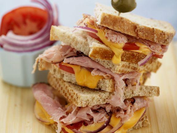 Sandwichs mit Zwiebeln und Tomaten ist ein Rezept mit frischen Zutaten aus der Kategorie Fruchtgemüse. Probieren Sie dieses und weitere Rezepte von EAT SMARTER!