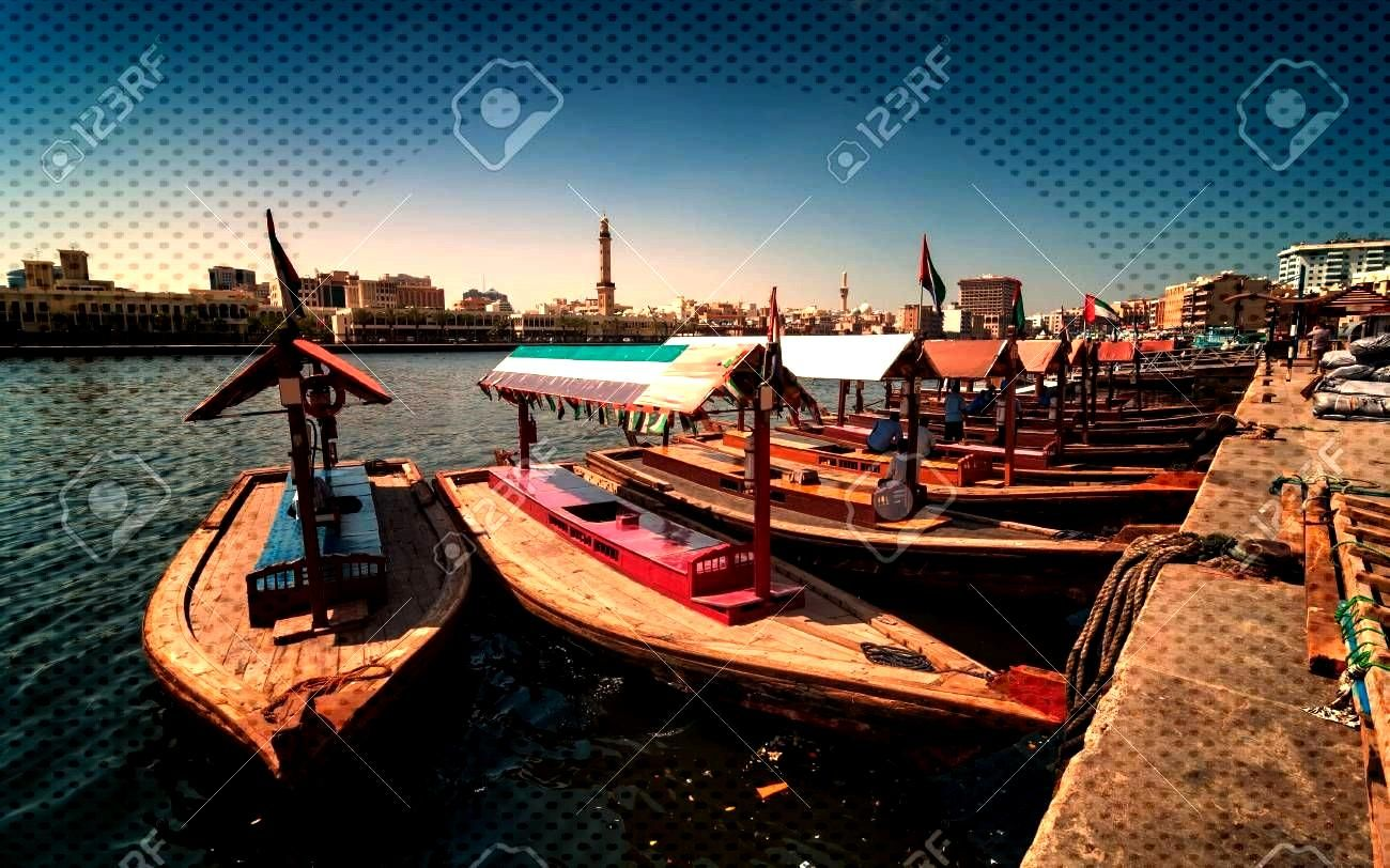 Traditional Abra taxi boats in Dubai creek - Deira during sunny day, Dubai Deira, United Arab Emira