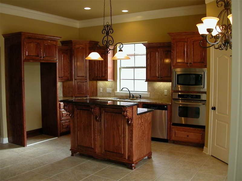 Kitchen Paint Colors With Oak Cabinets with porcelain floor -- love that  khaki paint color