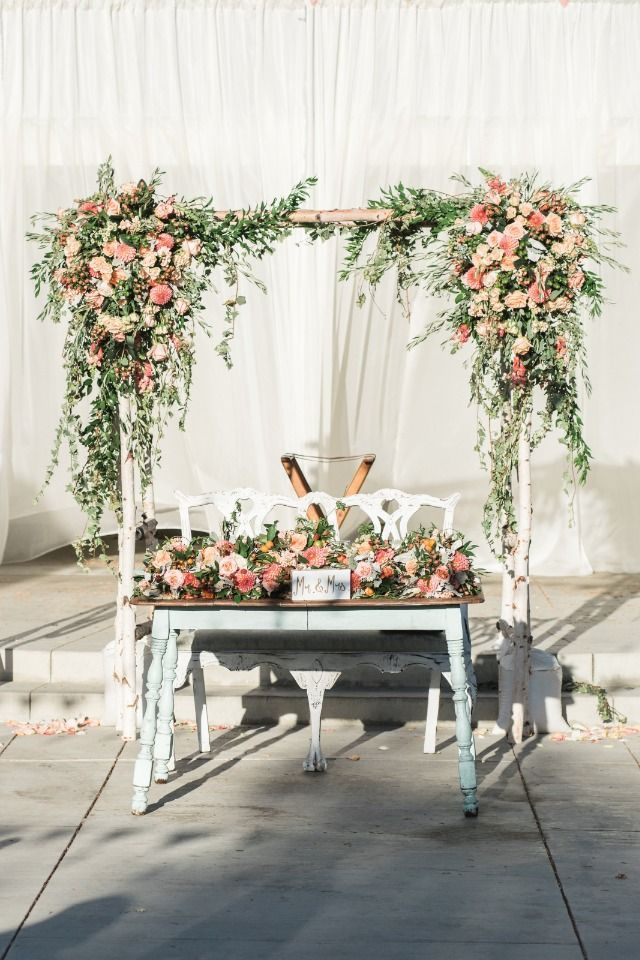 Photo of Use your wedding arbor for your sweetheart table backdrop