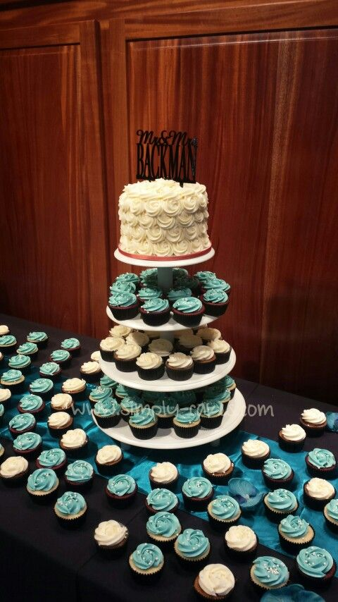 Small rosettes wedding cake and cupcake tower Www.facebook.com/simplycakes.brittneyshiley