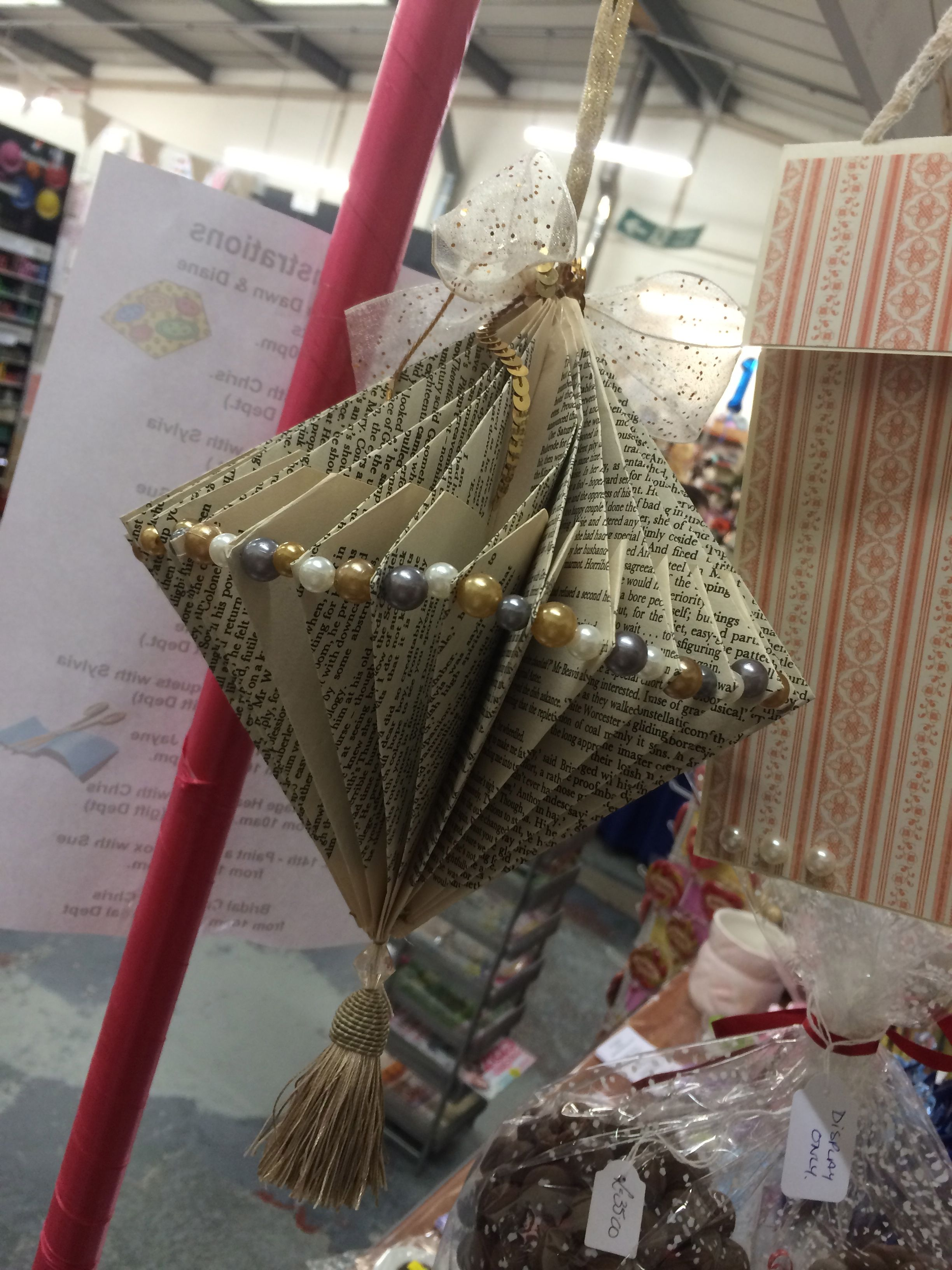 Make a hanging bauble out of an old book. Demonstrated by Dawn in-store.  #christmas #bauble #book #recycle #decoration #tassle
