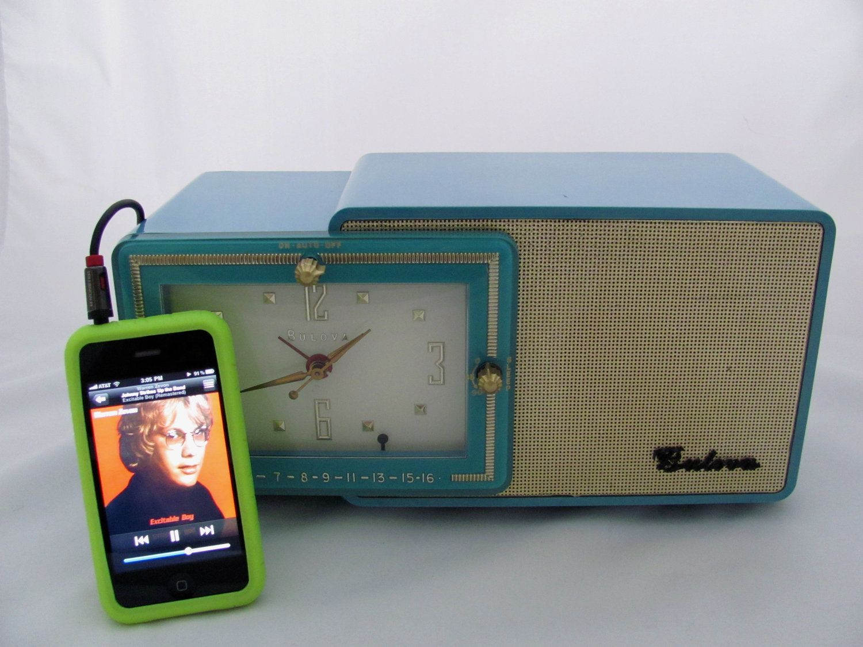 Blue Bulova Clock AM Radio iPod Ready,1957 Restored, via Etsy.
