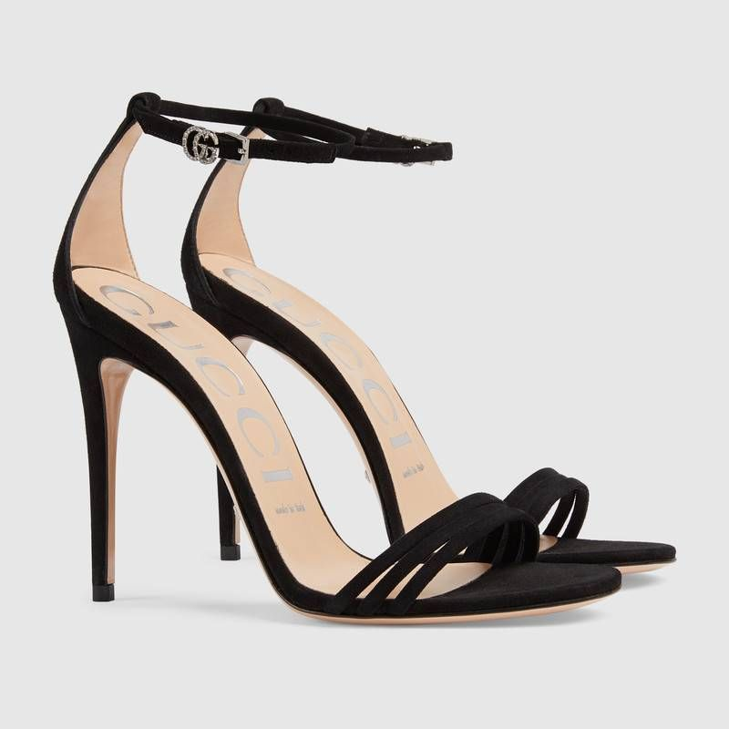 a774a1ce6 Shop the Suede sandal by Gucci. Crafted in black suede, the high-heel sandal  sports a subtle design with a thin heel and three front straps.