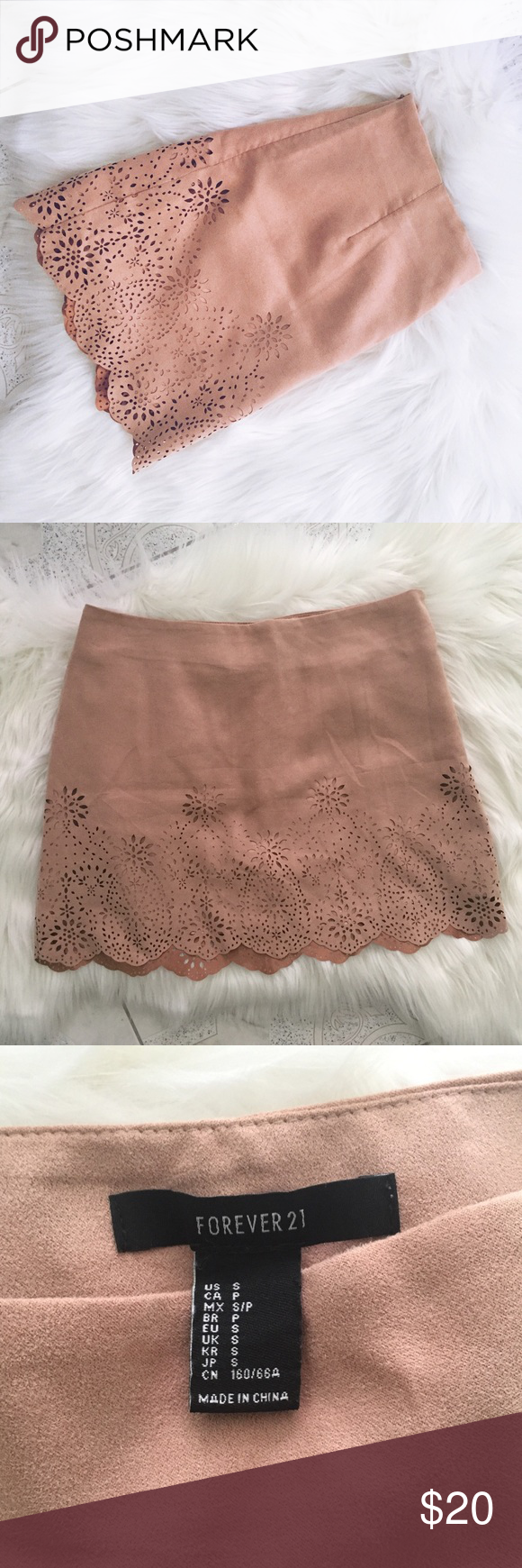 """Forever 21 Faux Suede Scalloped Skirt F21 Faux Suede Scalloped Skirt. Size S. Color most accurately shown in Pic 3. Never been worn. I'm 4'10"""" and 105 lbs, and the skirt is a little too big in the waist for me. Material for Shell is 100% Polyester and Lining is 100% Polyester. Instructions state to Hand Wash Cold and Line Dry. Forever 21 Skirts"""