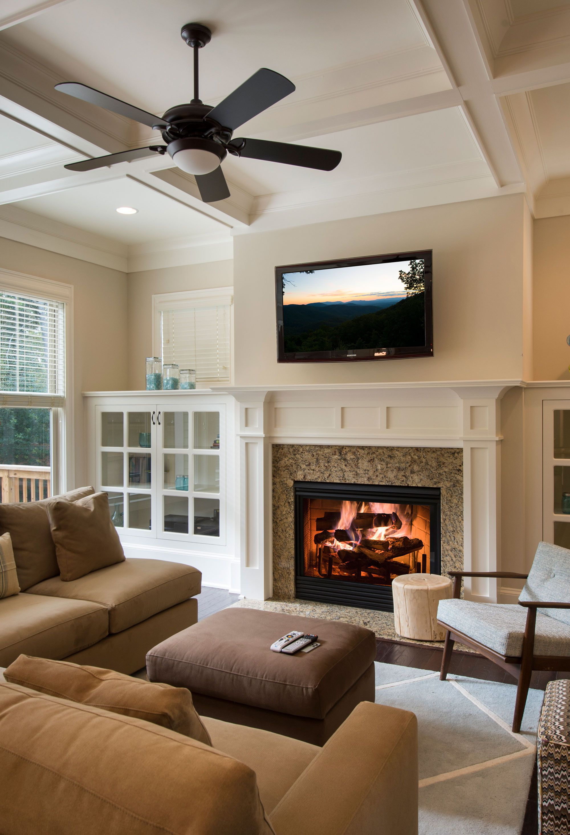 Warm Classic Living Room With Stone Fireplace And Built-in