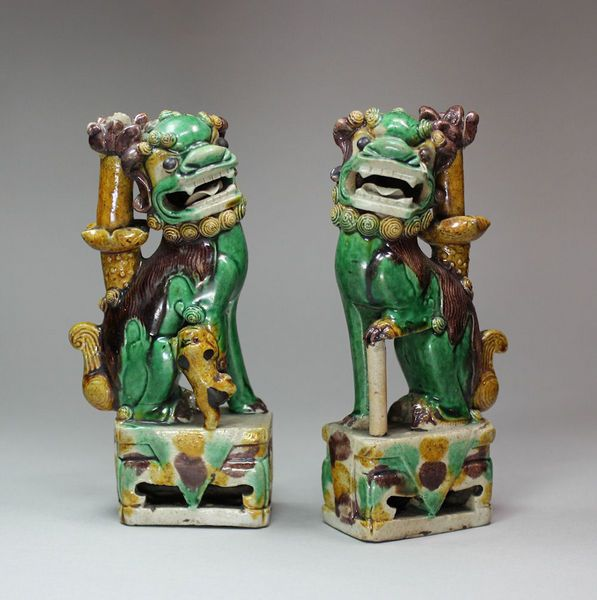 Pair of Chinese biscuit dogs of Fo incense burners, Kangxi (1662-1722), decorated in ochre, green and magenta enamels, height: 6 1/2in. 16.5cm and 6 5/8in. 17cm