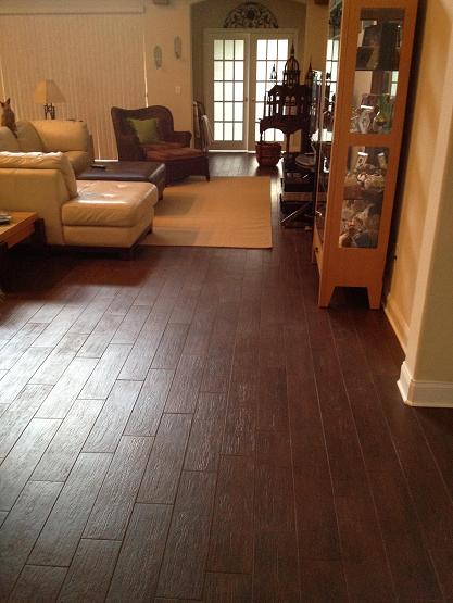 "6x24 ""Walnut"" porcelain plank tile installation throughout"