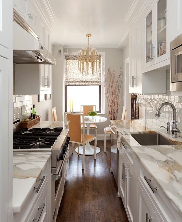 High End White Kitchen: Stylish Galley Kitchen In Shades Of White And Grey With