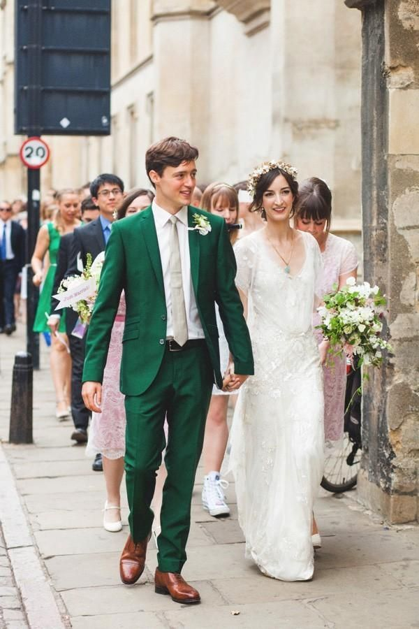 Groom In Emerald Green Suit Holding Bride S Hand Myweddingdotcom