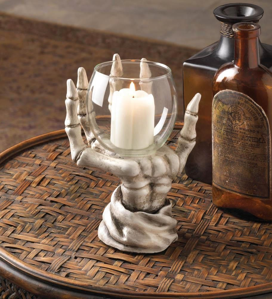 Skeleton hand candle holder skeletons