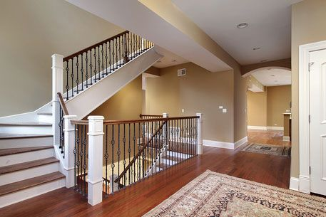 High Quality Foyer With Stairs, Wrought Iron And Wood Railing And Special Molding