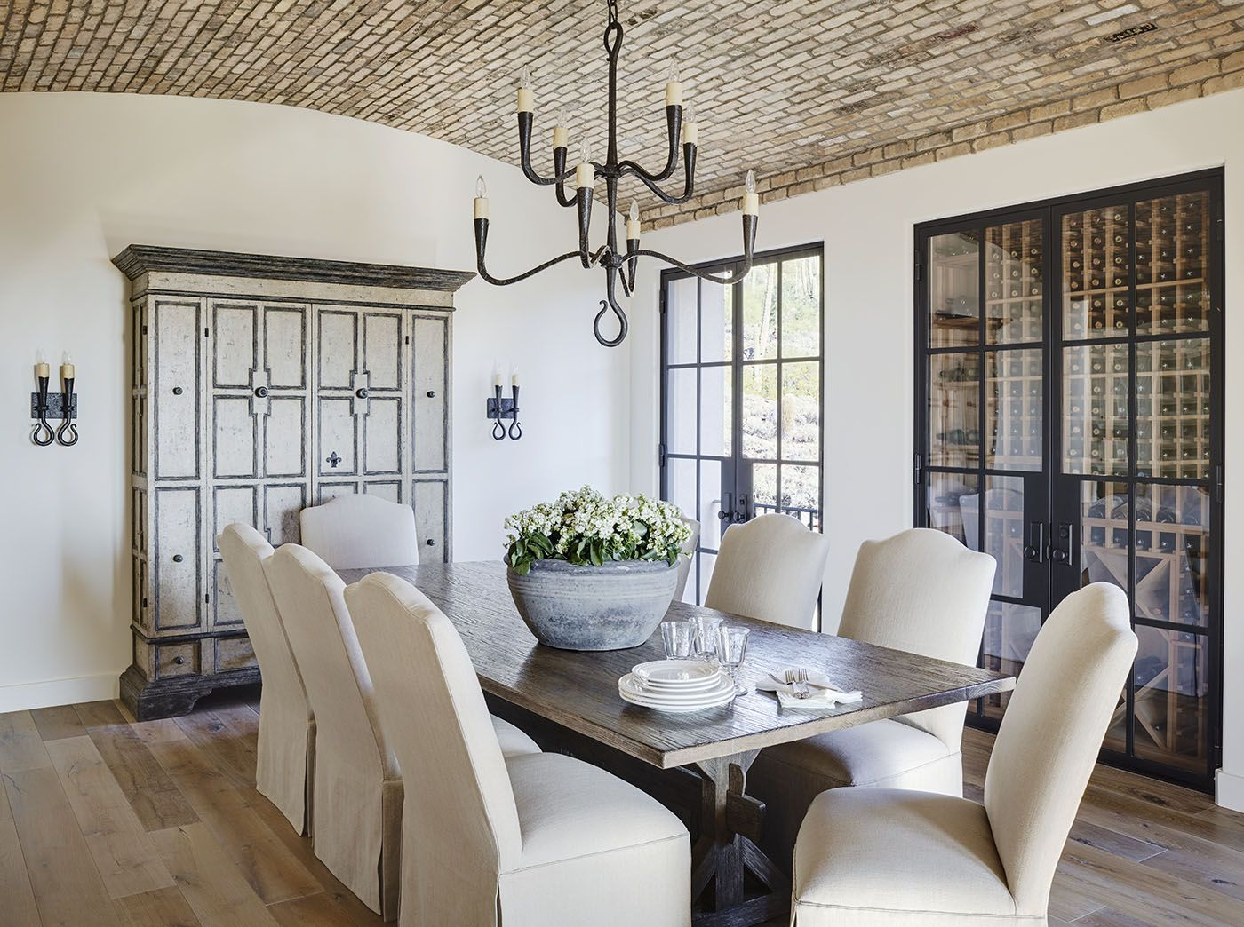 luxury dining room with brick barrel vault ceiling