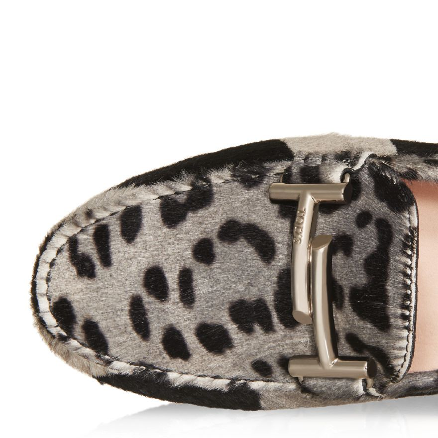 Gommino driving shoes in animalier calfskin with Double T buckle in branded metal, exposed hand stitching and iconic rubber pebble outsole.