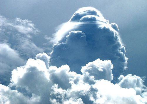 clouds form when the invisible water vapor in the air condenses into