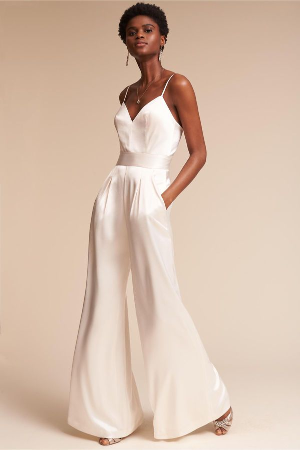 ea5c16c6d10 White silk jumpsuit! Perfect for the modern bride! Love this for a wedding  reception!