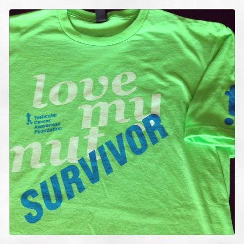 41432488 Testicular cancer awareness merchandise. Love My Nut Survivor Shirt. 100%  of proceeds go to the Testicular Cancer Awareness Foundation.