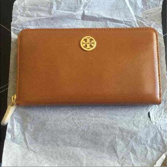 """Tory Burch Dena Zip Continental Wallet This is 100% authentic, I purchased online from Tory and never used it.  There is plastic covering the front logo and protective covering over the two zipper pulls that say Tory burch.  There is a small scratch next to the Tory logo on the front and the back there are spots in the leather (it came from Tory like that).  The inside has lots of credit card slots and a zippered middle part.  Genuine soft leather in """"luggage"""" color. Tory Burch Bags Wallets"""
