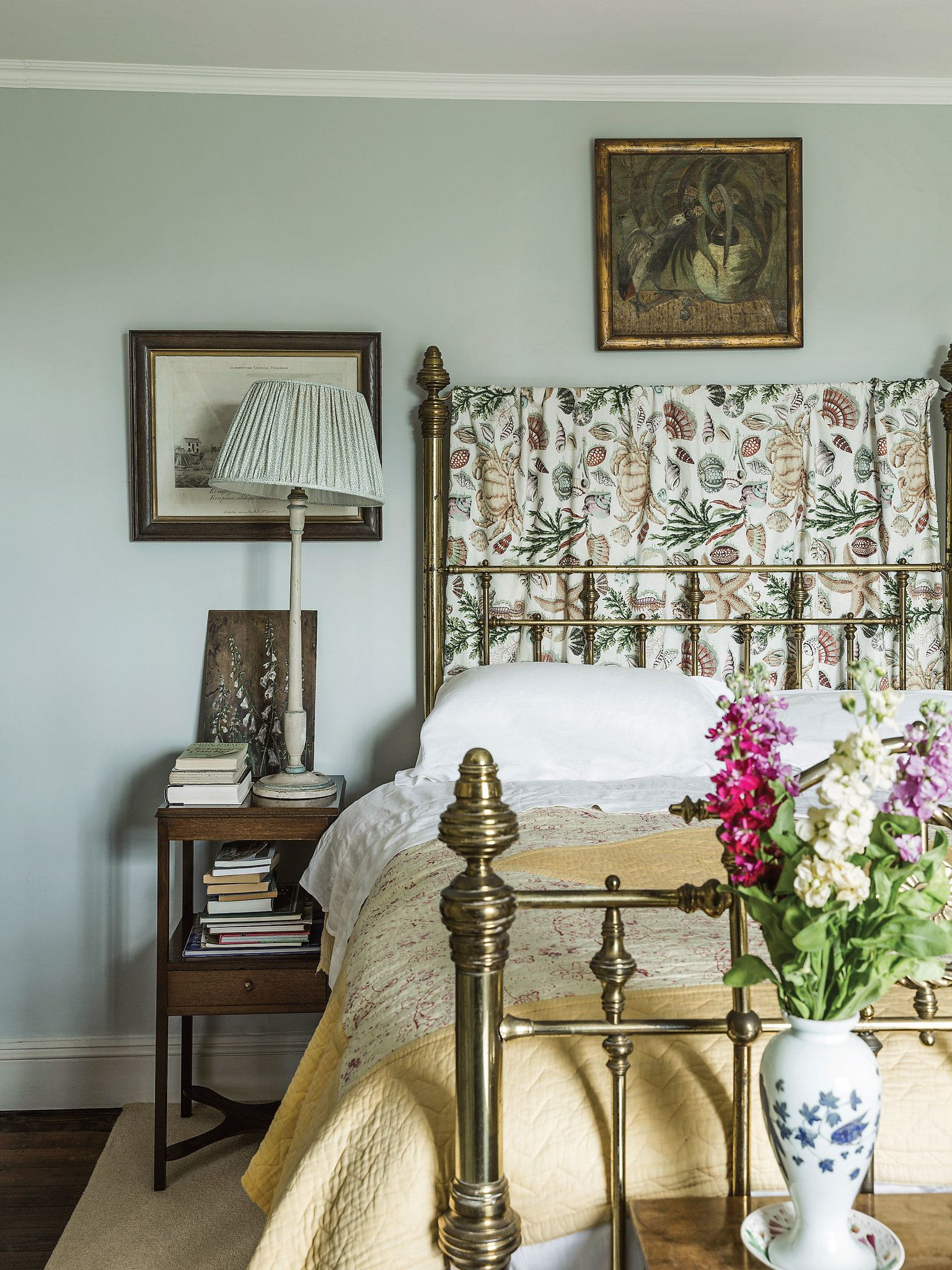 In The Guest Room A Painted Wood Lamp With Textile Shade Next To