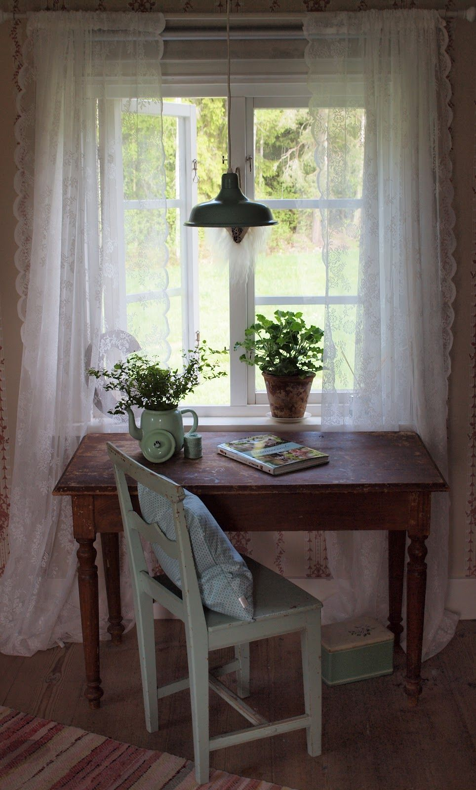 A Writing Table Next To Window Looking Out Onto Garden
