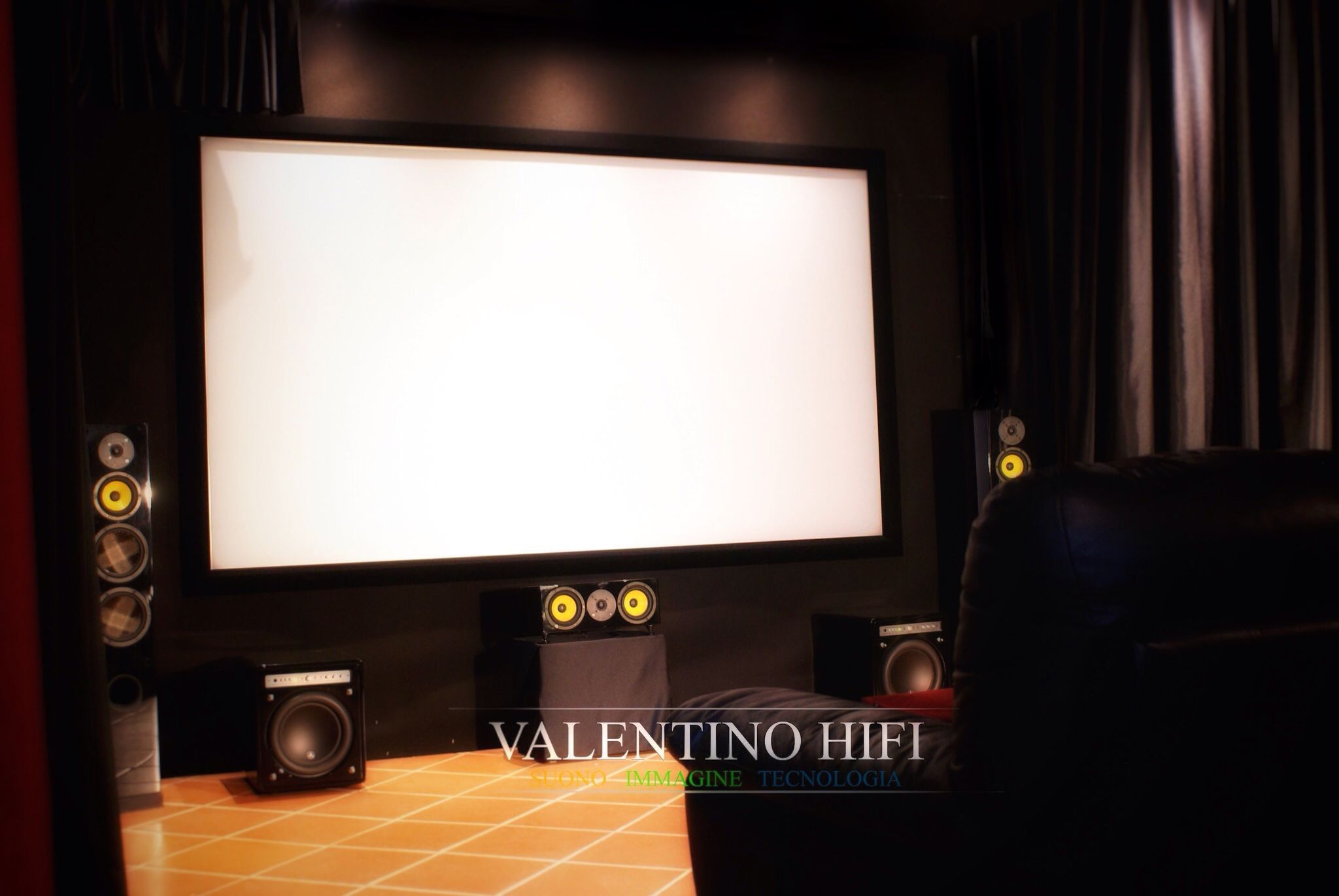 Home Theater Speakers Placed Behind Acoustically Transparent Screen - Cedia