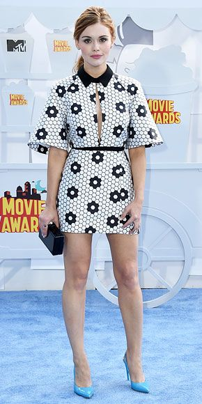 The Boldest Style at the MTV Movie Awards | HOLLAND RODEN | The Teen Wolf star has a mod moment in a black-and-white design featuring a collar and sexy keyhole neckline. She adds a pop of color via her blue patent pumps.