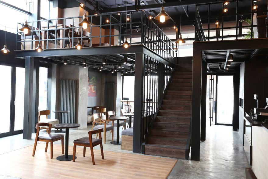 the design of the two levels keeps the space open and inviting but makes it multi - Multi Cafe Decoration
