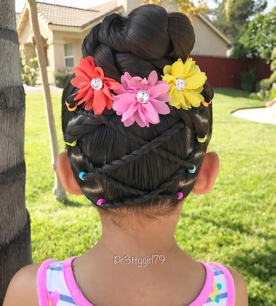 Elastic crisscross twist braids into a high braided bun ...