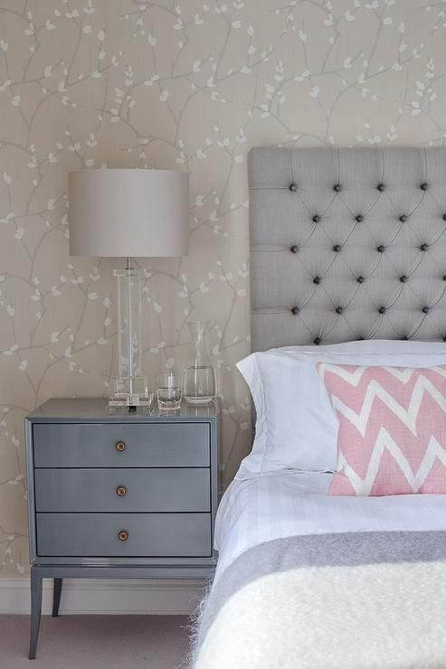 Gray and blue bedroom features an accent wall clad in for Grey feature wallpaper bedroom