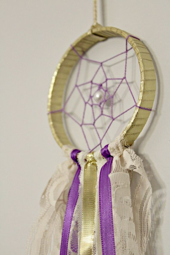 Small Dreamcatcher in Gold, Cream and Purple  Measures 3 across hoop by 13 long (not including ribbon hanger)  The hoop is wrapped in shiny gold