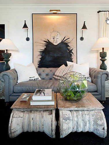 Very cool coffee tables and wall art. The whole room is framed perfectly