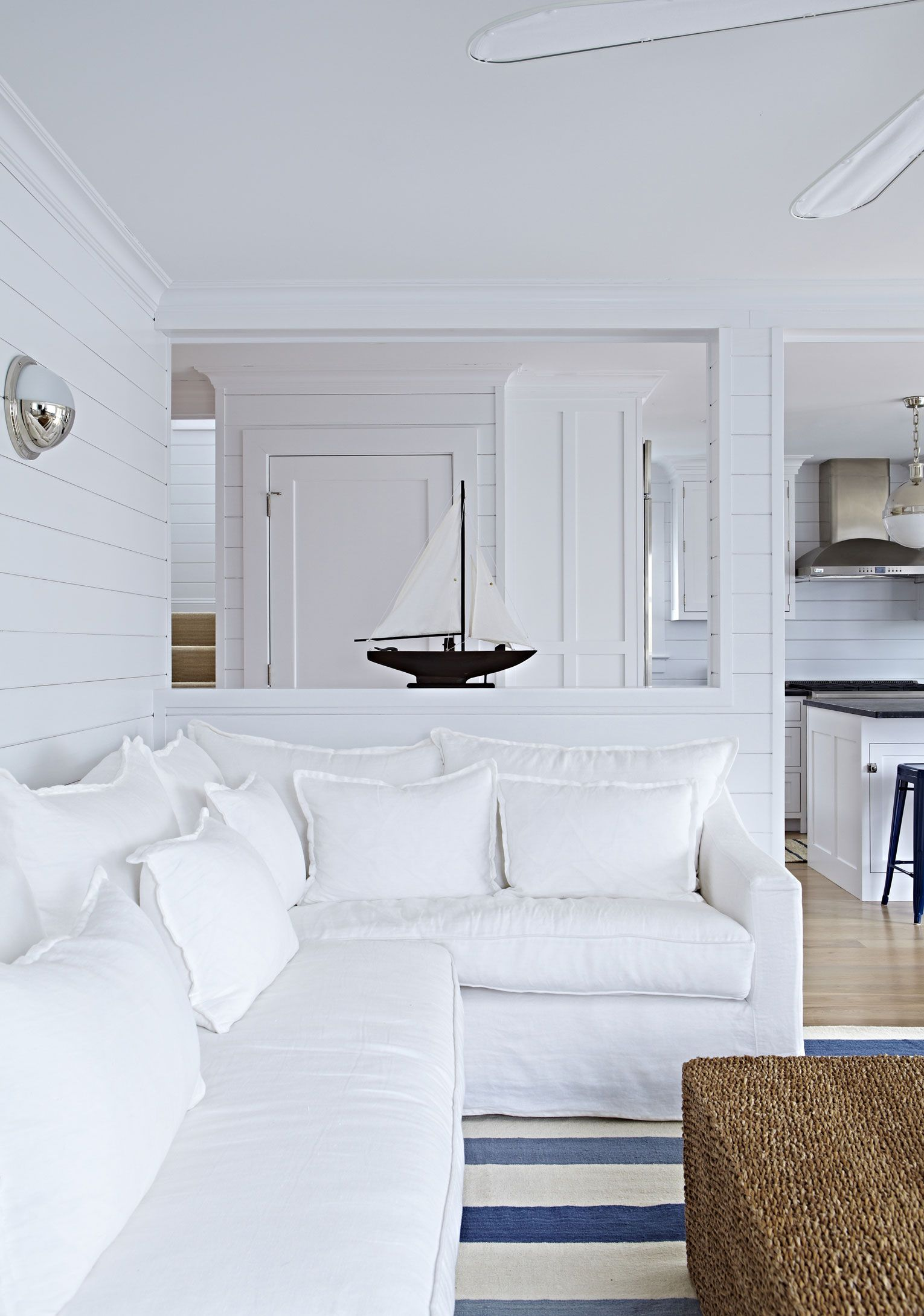 Beach Bungalow White Living Space With Blue And White Area Rug