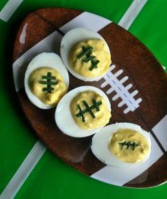 Last-Minute Deviled Eggs: Perfect little footballs for your Super Bowl appetizer buffet! These are so easy! | via @SparkPeople #food #recipe #party