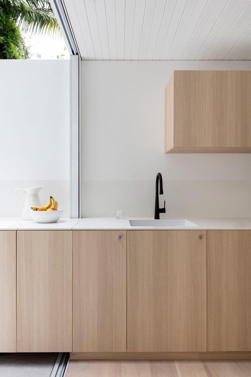 Worktop extends from kitchen to garden in Sydney residence by Benn + ...