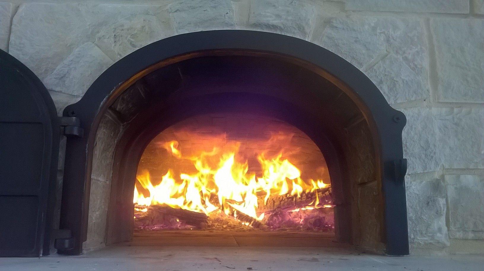 Burn baby burn  #fire, #brickoven, #stone, #outdoorkitchen, #wood, #castiron, #woodfired,