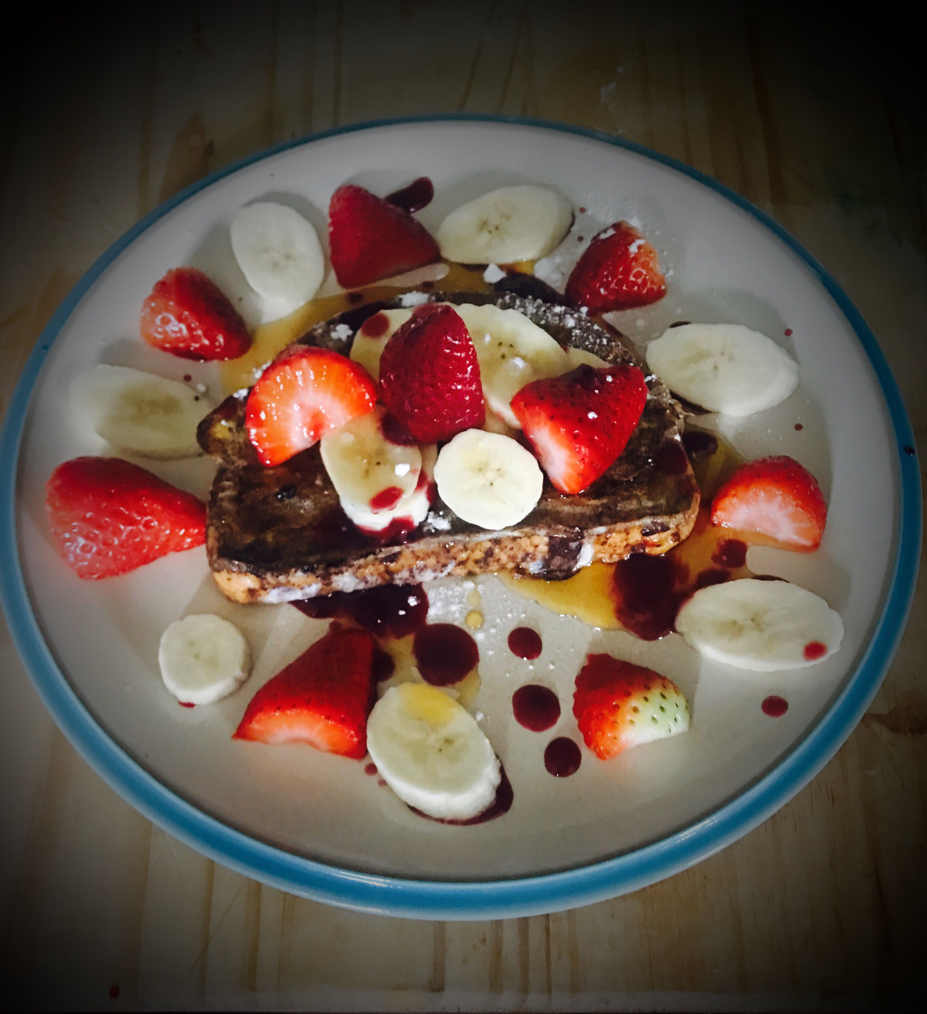 Sourdough French Toast, with Fresh Fruit, Cherry Drizzle and Maple Syrup.