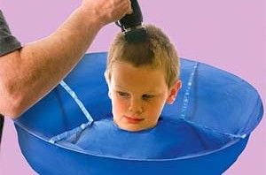 Haircut Umbrella... looks hillarious, but wow that would save my boys a lot of grief when I cute thier hair!