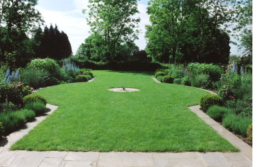 long lawn with circular element might be more effective if outlined with pavers